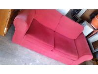 Two seater red sofa bed. Delivery.
