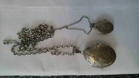 Pair of antique silver lockets