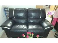 Real leather black recliner sofa white trim