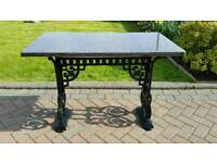 Victorian Cast iron table with Granite top.