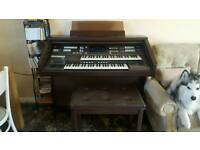 Electric piano with double seat