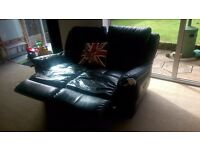 Black leather sofa reclining