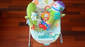BRIGHT START BABY BOUNCER CHAIR WITH PLAY PILLOW