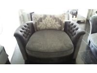 Designer sofa with matching swivel chair