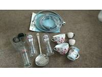 Bits and bobs. Cups, glasses, washing machine hose, pots, hooks and a floor grip.