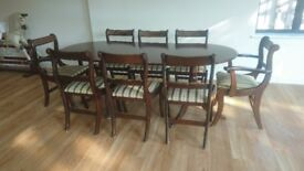Extending dining table and 8 chairs, 92cm wide, extends from 145cm to 191cm long