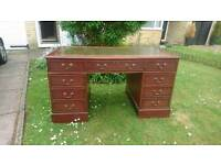 A large leather top desk