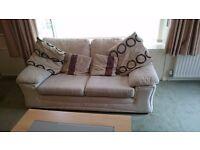 Cream sofa with four cushions