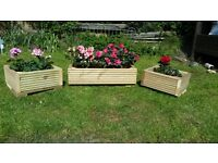 3 wooden planters ideal for gardens or patios