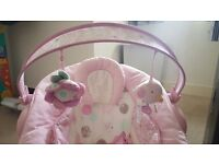 Lovely pink comfort harmony bouncer with music sounds and vibrating motion