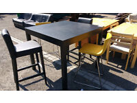 Black kitchen/breakfast table with 4 stools