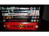 Small pile of Dvds mainly military films.