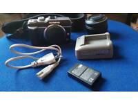 Olympus Pen E-PL1 Silver with black. Perfect for beginners.
