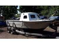 20 ft fishing/day boat with 55 hp main outboard, 4 hp aux outboard and trailer