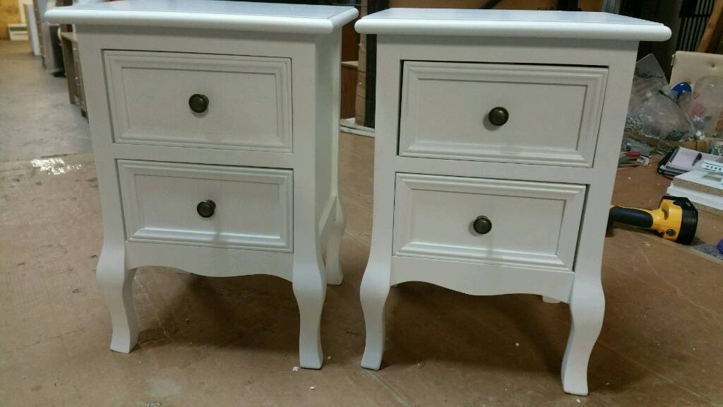 A brand new pair of stylish white finish 2 drawer bedside tables.