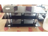 LARGE GLASS TV STAND IN EXCELLENT CONDITION