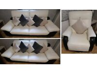 Lovely and modern Cream and Black Large 2 seater sofa and matching spinning chair very stylish