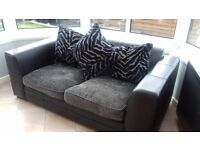 Black and grey two seater sofa with matching tub chair