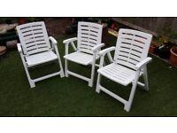 3x White plastic garden chairs