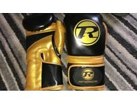 Ringside Pro Fitneas boxing gloves. Wore. a couple of times and in mint condition.