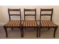 Three dark wood chairs