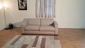 Ex-display Siesta oatmeal fabric 2,5 seater sofa bed