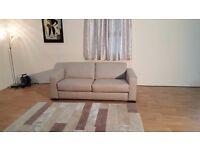 Ex-display Siesta oatmeal fabric 2,5 seater sofa bed