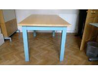 Kitchen table - top made from solid maple/painted legs manufactured by Newcastle Furniture Co. Ltd.