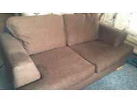 Two brown three seater sofas