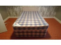 Small double divan bed.