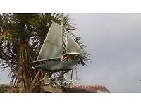 gaff sail boat weather vane