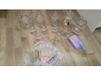 Variety of sweet jars for sale, including bags, tongs and scoops