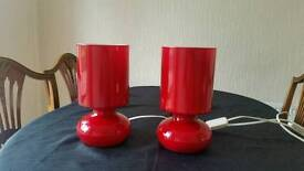 2 red glass bedside or lounge lamps