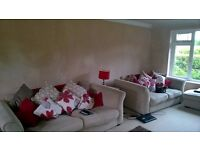 Comfy Two Seater Sofa for sale......the one on the right of the photo ***URGENT SALE REQUIRED***