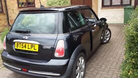 Mini Hatch Cooper. Astro Black and Cloth/ leather 1.6 3 dr petrol. MOT Sept 18. Low mileage.