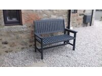 Wooden garden bench painted in trendy grey colour
