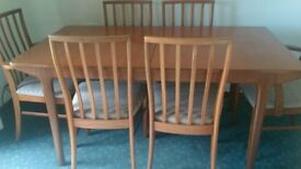 Solid wood extendable table and 6 chairs, including 2 carvers.