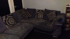 large silver gray conwr sofa and swiv chair and footstool