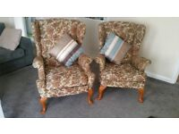 A rare pair of Parker Knoll Floral Vintage Wingback Armchairs Recliner