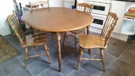 Expandable dining table and four chairs