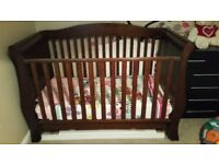 Brown sleigh cot with mattress