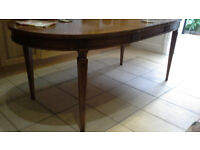 Beautiful highly polished walnut dining table with four chairs