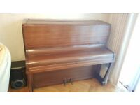 MAKE AN OFFER - Upright Piano with 7 octaves-fantastic condition, both pedals work, needs a new home