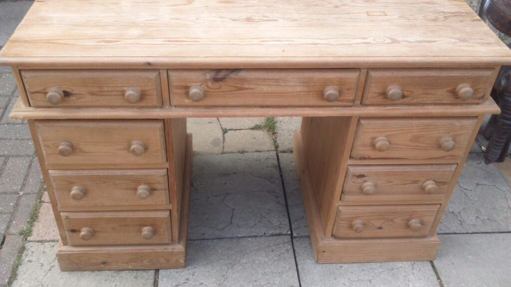Pine knee hole deskin Attleborough, NorfolkGumtree - Pine knee hole desk solid pine waxed finish. 9 drawers in total Showing signs of wear painter or relaxer Splits in three for transport two pedestals and top Height 77cm Width 121cm Depth 62cm