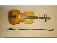 Eighth size violin including case, bow and resin