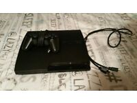 Sony PlayStation 3 Slim 120GB Black with Dualshock 3 controller and cables