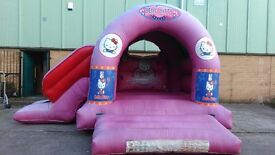 Bouncy Castle 17ft x 15ft with slide.