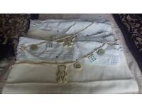 Cream nursery bedding and curtains