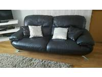 Real leather black 2 and 3 seater sofa