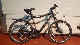 Diamondback stealth, very good condition, gel seat/lights/mudgaurds/chain with 2 keys/unused helmet